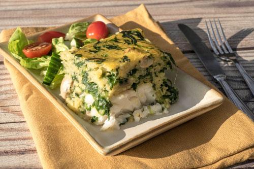 Polentataart met kabeljauw, spinazie en champignons